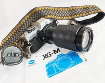 Vintage Minolta film camera XG-M with zoom lens Zykkor 80-205mm SLR