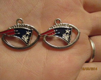 Set of 2 New England Patriots football charms.