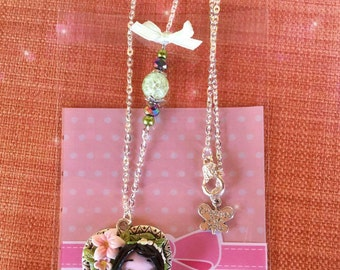 Necklace doll with flowers
