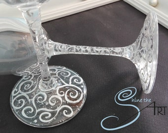 2 hand painted champagne glasses spinning design