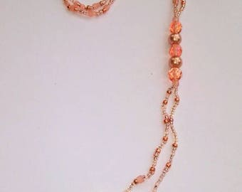 Peach overhead necklace with swarovski drops.