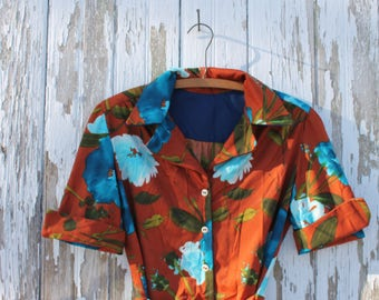 Handmade vintage button up, tie waisted, short sleeved, collared shirt, burnt orange with blue roses, white buttons, medium
