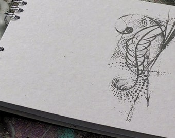 A tattooed spiral notebook