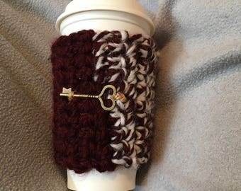 Crocheted coffee cozie with heart key