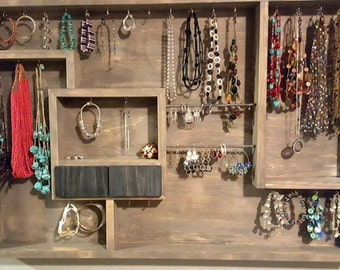 Hang on the wall jewelry organizer with ring drawers.