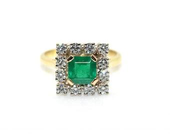 Surrounding emerald ring