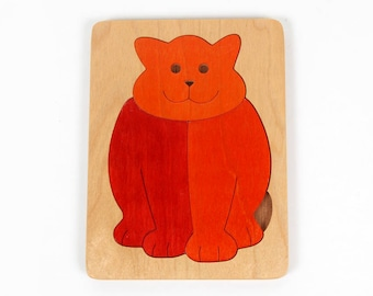 Vintage puzzle-wooden jigsaw puzzle of an orange cat