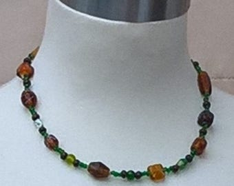 Stylish Bead necklace of Earth colours Brown,Red and Green. Made from recycled materials.
