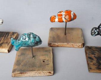 fish ceramic Raku backed with iron and wood