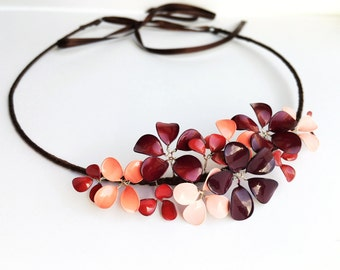 Headband with delicate blossoms in shades of berries