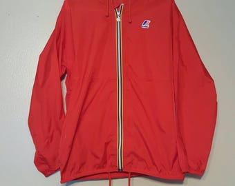 Red K-way packable windbreaker jacket