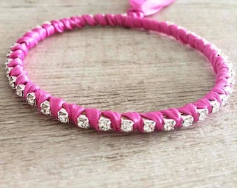 Rigid bracelet with pink crystals