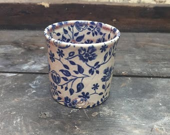Cup turned stoneware, oxides under enamel decoration.