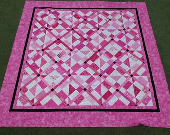 Scrappy pink and white quilt top