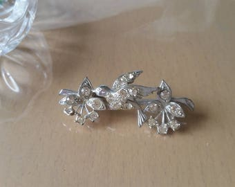 Vintage 1950's clear crystal encrusted bird brooch
