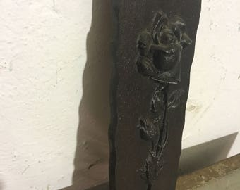 Cast iron wall relief