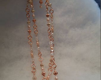 Copper and pastel pink glass pearls.
