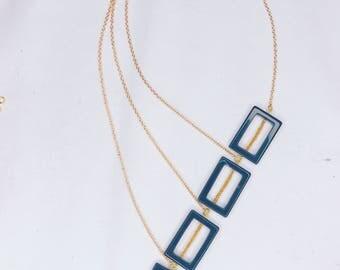 Liz unique, simple, asymmetric black and gold necklace.
