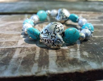Teal and silver beaded heart bracelet.