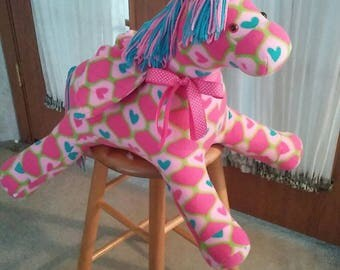 Pegasus for baby girl in pink n turquoise fleece. Hypoallergenic stuffing. Safety eyes. Yarn main n tail. 25 inches long. 18 high.