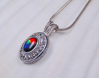 Ammolite pendant.Brilliant grade AA makes a big impact in a small package.Quality tells!