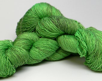 Mean It on Superwash Merino Wool and Silk Blend High Twist Single Fingering Yarn Kettle Dyed vibrant lime green