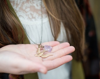 so i fly . a brass bird with amethyst necklace