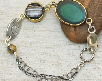 Oval malachite bracelet in brass bezel setting with round agate secondary gemstone and oxidized sterling silver double chain