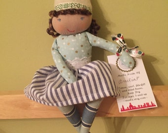 AMELIA, a Christmas Kindness Elf from MiaLa Nordic Holiday Collection 2016. Brown haired softie girl doll.