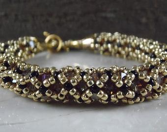 elegant golden crystal and seed bead woven round tubular bracelet