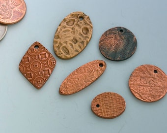 Handcrafted Bronze Clay and Copper Clay Charms. 6 handmade charms, roughly 22 grams. Natural patina. Lot C.