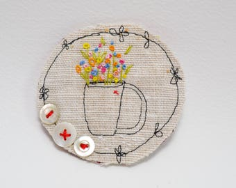 BROOCH Textile - free machine and hand embroidered.  Vase of flowers