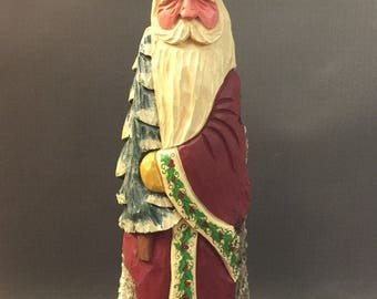 HAND CARVED original tall Santa with tree and detailed holly trim from 100 year old Cottonwood Bark.