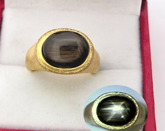 AAA Black Star Sapphire   11x9mm  4.15 Carats   in Ladies 18K Yellow gold cocktail ring 10 grams. 2643