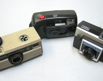 Vintage Trio of Film Cameras, 2 Kodak Instamatics for Display and a Working Pentax P-313 35mm Camera