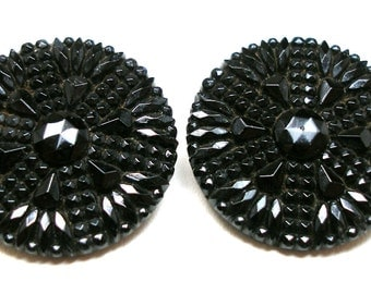 "2 Vintage GLASS buttons,  Black glass stars, flowers, 1""."