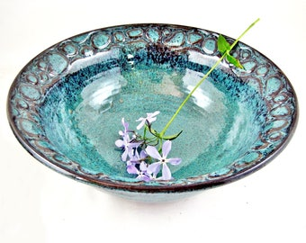 Handmade stoneware searving bowl in teal blue glaze, River rock carving design - In stock