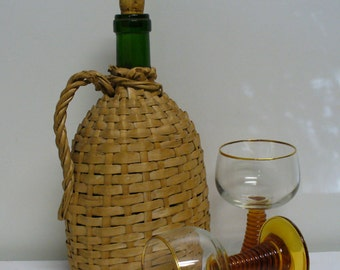 Mid-Century Wicker Covered Green Bottle