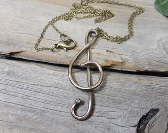 Treble clef necklace, brass treble clef necklace, musical jewelry designs, trebleclefdesigns,statement necklace, nickel free,