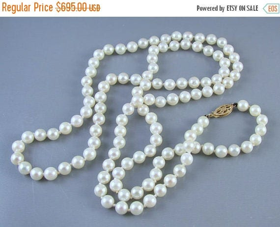 SPRING CLEANING SALE Vintage 30 inch 5.5mm hand knotted opera length genuine cultured salt water pearl necklace strand with 14k gold filigre
