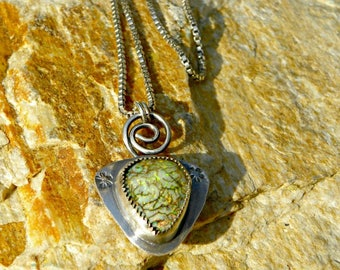 Cultured opal pendant in sterling silver