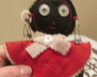Vintage black Americana hand made felt rag doll hanging folk art thread spools