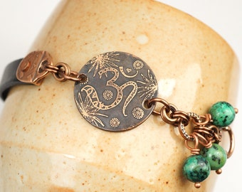 Blue Tibetan om bracelet, yoga jewelry, metal etching, African turquoise beads, 7 1/4 inches long