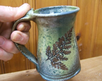 """READY to SHIP ceramic coffee mug in """"Green Leaf Glaze"""" with rabbit's foot and oak"""