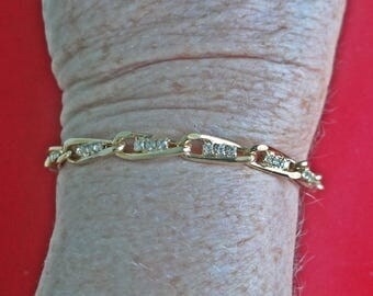 """Unsigned AVON Vintage gold tone 7"""" bracelet with rhinestones in great condition, appears unworn"""