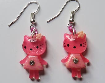 Pink Hello Kitty style earrings with diamate decoration