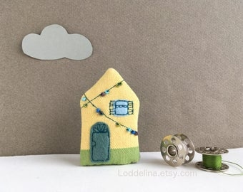 Tiny HOUSE brooch. Pale yellow with blue window and party lights