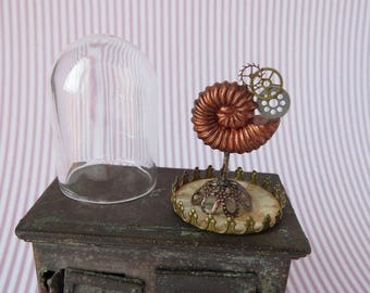 Steampunk ammonite with gears under glass dome in 1:12 scale