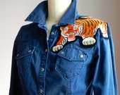 jean shirt with a large tiger patch, women's size medium