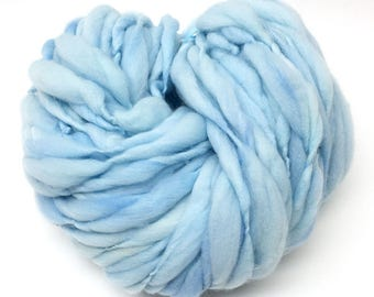Thick and thin handspun yarn, hand dyed in shades of baby blue merino - 53 yards, 3.1 ounces/ 88 grams
